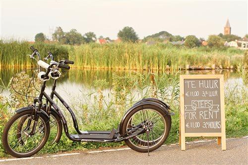 Kickbike steppen door Waterland in Watergang, Noord-Holland